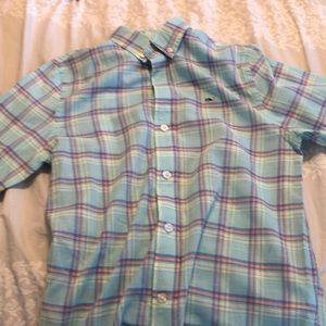 Teal, salon, and blue button down shirt.